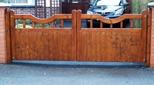 Redwood driveway gates stained and fitted