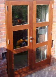 Solid Sapele, double glazed, three panel french doors and matching frame