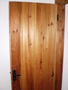 Douglas fir ledged and braced cottage style door with matching frame,skirting board and architrave