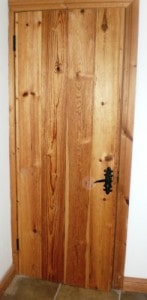 Douglas fir ledged and braced cottage style door with matching frame, skirting board and architrave