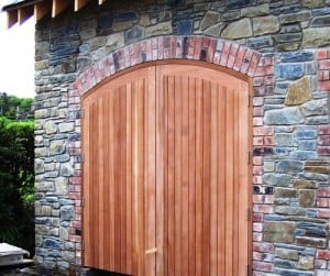 Arched top Sapele garage doors and frame after fitting