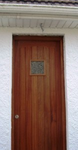 Solid Sapele ledged and braced door and frame with double glazed vision panel