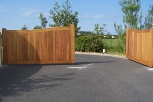 View of opened bespoke Iroko hardwood entrance gates in Co Down