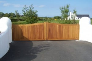 Bespoke Iroko hardwood entrance gates after fitting in Co Down