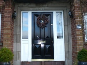 Painted solid Sapele four panel door with matching double glazed side lights