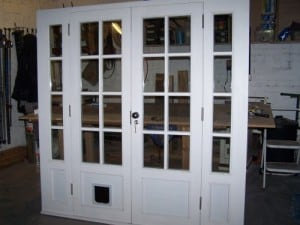 Painted double glazed French doors with matching frame and side lights