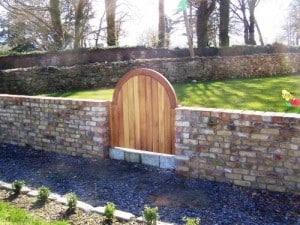 Made to measure arched top Iroko pedestrian side gate for Firdale House Co. Waterford