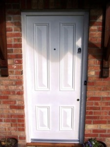 Painted, hardwood,four panel, Victorian style entrance door with raised chamfered panels and matching frame.