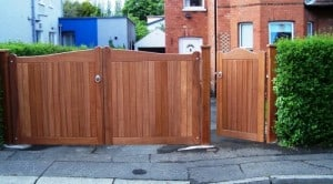 Bespoke Sapele hardwood driveway gates with matching pedestrian gate and posts in South Belfast