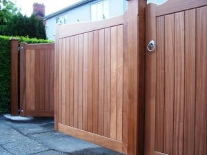 detail of bespoke Sapele hardwood driveway gates with matching pedestrian gate and posts in South Belfast