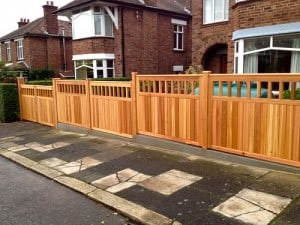 Western Red Cedar Bespoke driveway gates and matching fence panels in East Belfast