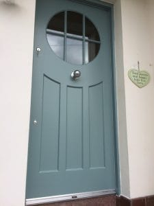 Contemporary 1930's style, painted hardwood front door with circular double glazed vision panel and matching frame