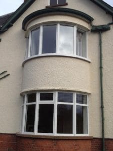 A new painted hardwood, double glazed, replacement traditional double bay window in Greenisland Co Antrim