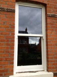 A new replacement, painted ,hardwood sash window in Belfast