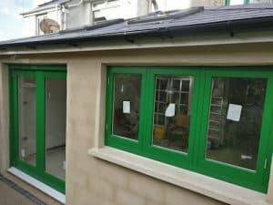 Hardwood, painted, double glazed, triple traditional casement windows and matching bi-folding doors in Belfast