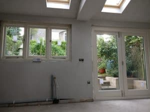 Internal view of hardwood, painted, double glazed, triple traditional casement windows and matching bi-folding doors in Belfast