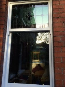 Replacement softwood, double glazed, painted sash window with original stained glass in Belfast