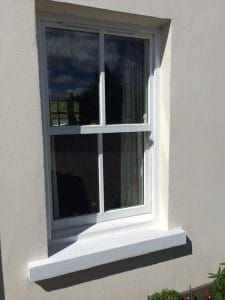Hardwood painted, double glazed sash window with a traditional single glazing bar applied in Ballynahinch Co Down