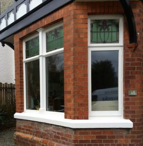 Traditional softwood, double glazed, painted casement bay window with bespoke stained glass in Belfast