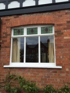 Traditional softwood, double glazed, painted casement window with bespoke stained glass