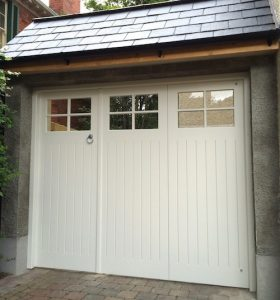 Bespoke, made to measure, 2/3 and 1/3 opening, TGV painted redwood garage doors and matching framein North Belfast