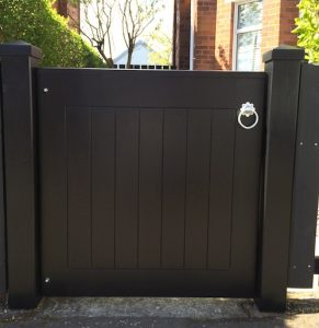 Bespoke, ebony coloured,contemporary hardwood pedestrian gate with matching posts in East Belfast