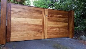 Bespoke, made to measure, contemporary Iroko hardwood entrance gates in East Belfast