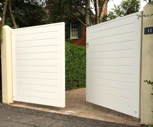 Bespoke, painted redwood, contemporary redwood entrance gates in North Belfast
