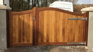 Bespoke, 2/3 opening out and 1/3 opening in, Iroko hardwood entrance gates in Carrickfergus Co Antrim