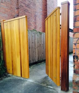 Bespoke, made to measure, Iroko hardwood driveway gates with matching posts in East Belfast