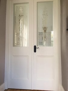 Bespoke, painted, redwood french doors with matching frame and bespoke sandblasted glazing in South Belfast