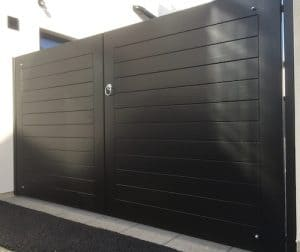 Bespoke, ebony coloured, contemporary style hardwood entrance gates in Annacloy Co Down