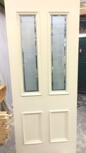 Four panel, hardwood, painted, bespoke front door with applied bolection moulding and sandblasted double glazing for fitting in East Belfast