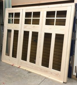 Georgian style, bespoke, garage doors and frame with 2/3 and 1/3 opening at the manufacturing stage