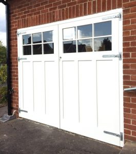 Painted redwood, panelled, Georgian style bespoke garage doors and matching frame in East Belfast