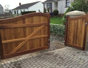 Rear view of bespoke 2/3 opening out and 1/3 opening in Iroko hardwood entrance gates in Carrickfergus Co Antrim