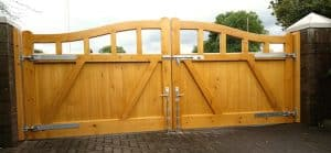 Rear view of bespoke, made to measure, light oak coloured, redwood open top driveway gates in Ballyclare Co Antrim