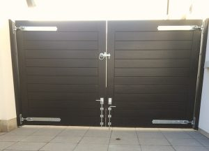 Rear view of bespoke, ebony coloured,hardwood contemporary entrance gates in Annacloy Co Down