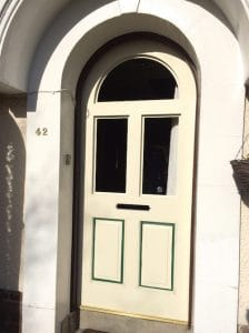 Semi circular front door replacement being fitted to the existing frame, before painting in North Belfast