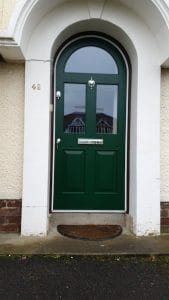 Replacement semi circular front door, painted, double glazed and fitted with door furniture in North Belfast